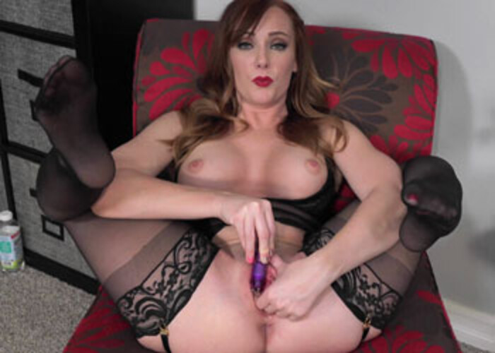 Ginger Dani's playing with a little vibrator