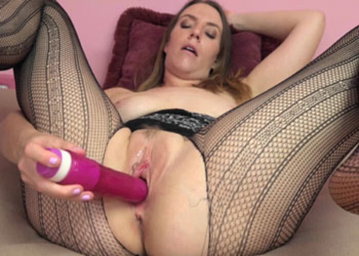 Alisha rips her fishnets to play with a dong